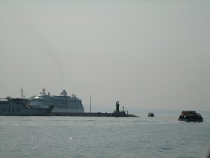 Cruise ship off harbor entrance