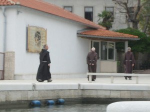 Monks Arrive by Boat for service at Monastery on Kosljn