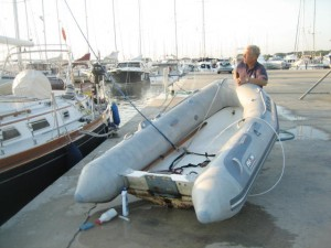 Cleaning and stowing dinghy