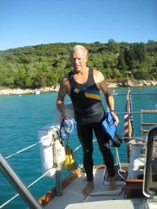 Another sign of the season--Kent in a wet suit to dive on the anchor