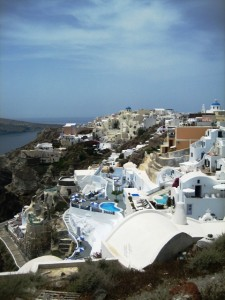 Buildings cascade down the hillside in Oia