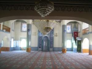 Mosque has an elaborate wall-to-wall rug and is bathed in light