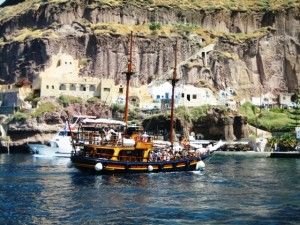 Traditional boats take tourists through the caldera