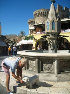 Jolie drinks at a fountain in Old Town