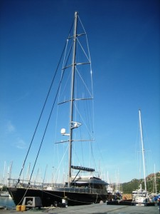Destiny is dwarfed by the mega-yacht whose mast is taller than we are long!