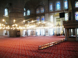 Between prayers, the Blue Mosque is empty except for visiting tourists. . .