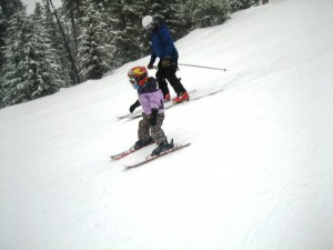 and charging down the slope with her Dad trying to keep up.