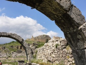 Arches of the Roman bath. . .frame the fortress in the distance.
