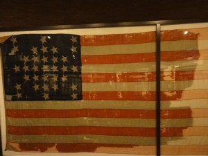 and one of the remnants of an original flag that flew over it when the Civil War commenced.